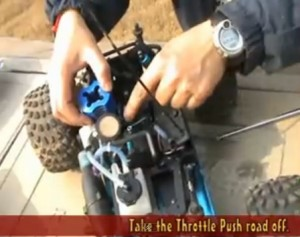 Take off the throttle push rod